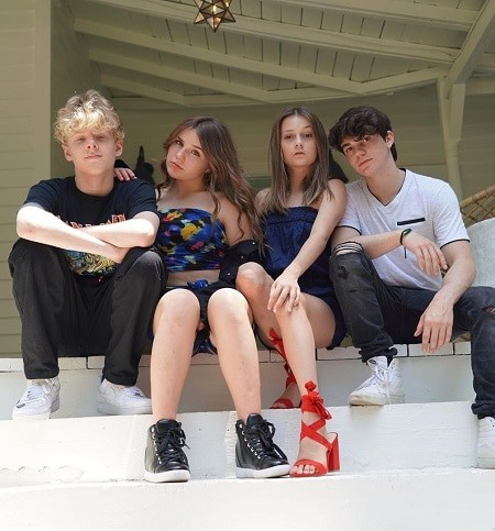 Lev Cameron, Piper Rockelle, Sophie Fergi and Jentzen Ramirez sitting on the steps of their house.