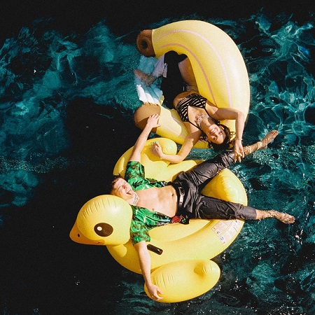 Ondreaz Lopez and Hannah Stocking on duck floaters in the Hype House Pool.