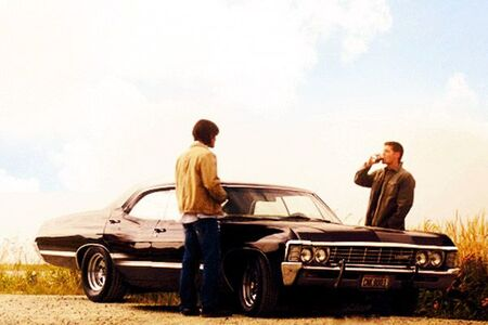 Sam and Dean Winchester with their beloved impala.