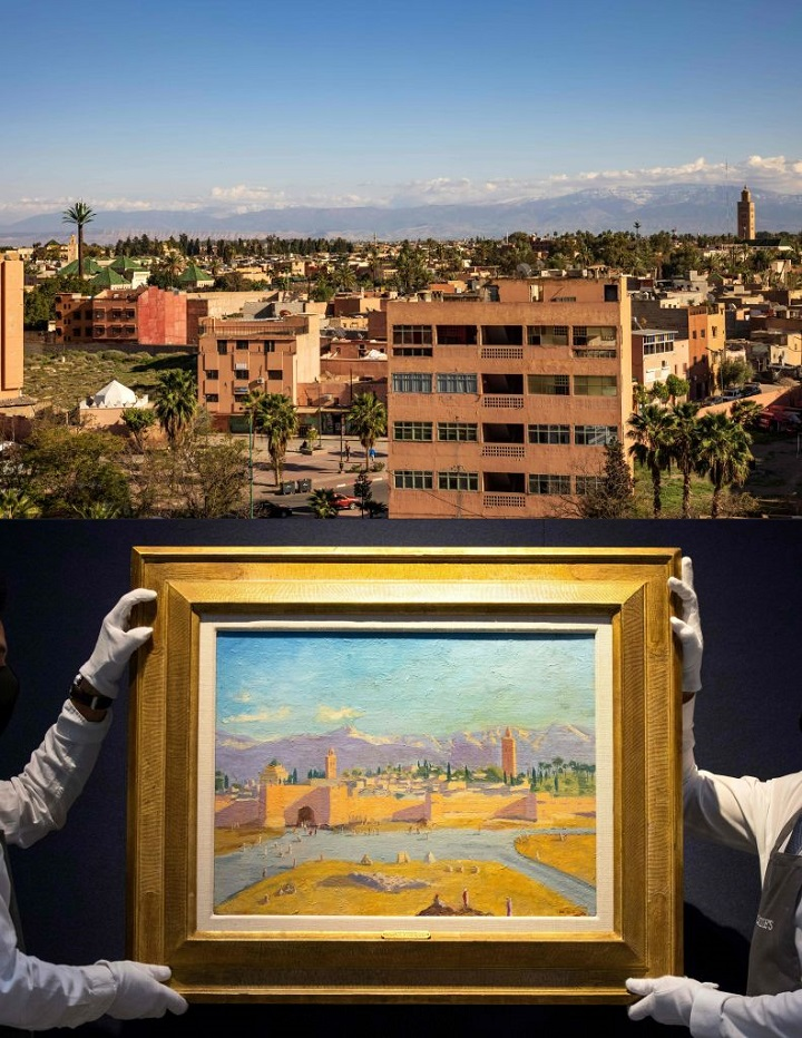 This combination of pictures created on February 25, 2021 shows (top) a general view of the Moroccan city of Marrakesh on February 24 , 2021, and (bottom) gallery workers pose with an artwork titled Tower of Koutoubia Mosque by Winston Churchill during a photocall at Christies auction house in central London on February 17, 2021. - Hollywood's Angelina Jolie and Britain's iconic wartime prime minister Sir Winston Churchill, a keen artist who took inspiration from the Moroccan city of Marrakesh, are combining for a March 1 date at Christie's auction house in London.